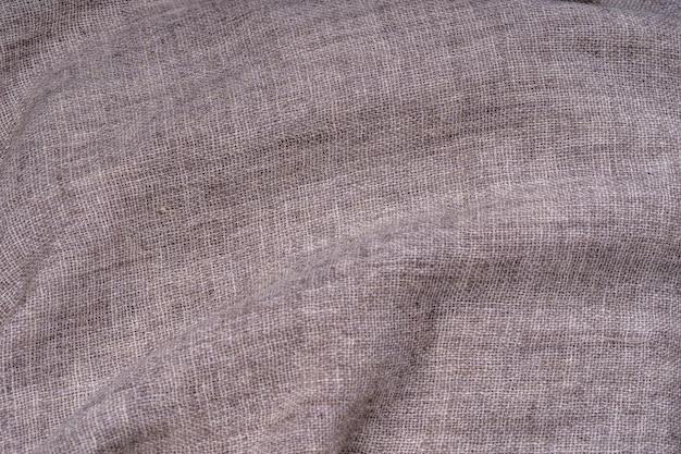 Zerknitterte textilbeschaffenheit als hintergrund. natürliche stoffleinenstruktur für das design. nahaufnahme