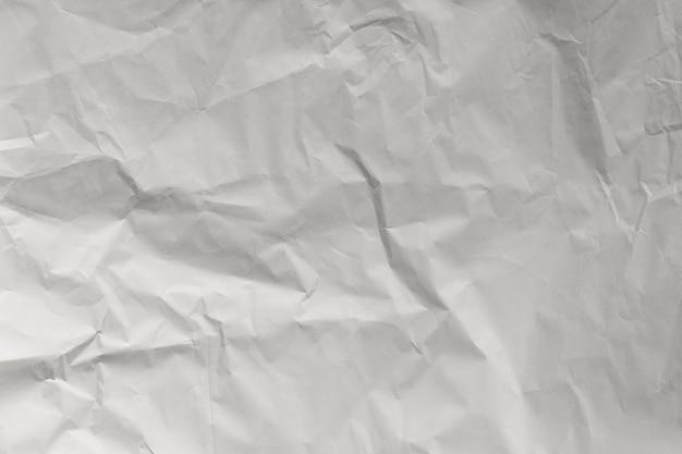 Zerknitterte weiße papierstruktur, papierhintergrund für design mit kopienraum für text oder bild.