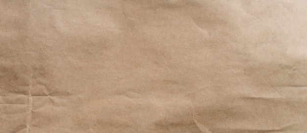Zerknitterter brauner papierhintergrund und beschaffenheit mit kopierraum.