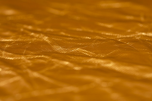 Zerknitterter goldener folienhintergrund