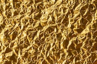Zerknitterter Goldfolien-Beschaffenheitshintergrund