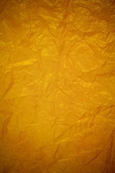 Zerknitterter goldrecyclingpapierhintergrund