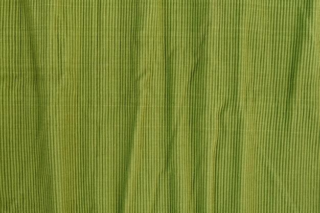 Zerknitterter grüner strukturierter baumwollstoff