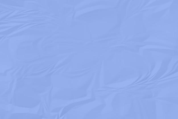 Zerknitterter hintergrundabschluß des blauen papiers oben