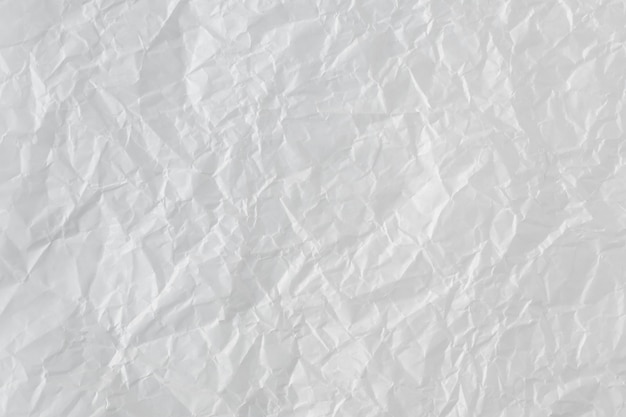 Zerknitterter papierhintergrund. abstrakte textur, oberfläche mit falteneffekt.