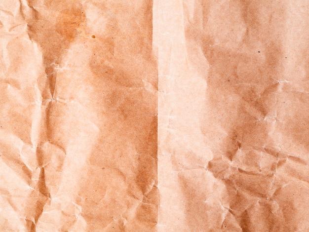 Zerknitterter papierhintergrund mit nahaufnahme