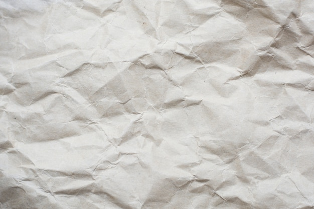 Zerknitterter sahnefarbtonpapiermuster-beschaffenheitshintergrund
