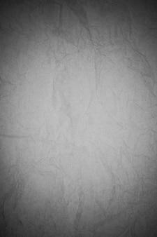 Zerknitterter schwarzer papierhintergrund.