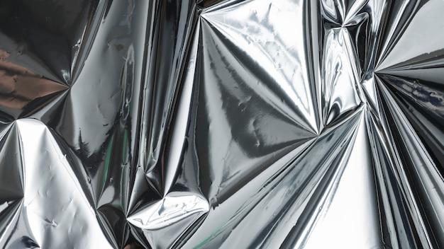 Zerknitterter strukturierter hintergrund aus aluminiumfolie