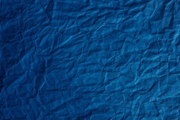 Zerknitterter strukturierter hintergrund des blauen papiers