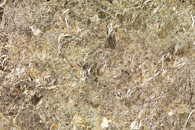Zerknitterter strukturierter hintergrund des metallischen papiers