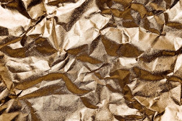 Zerknittertes goldpapier strukturierter hintergrund