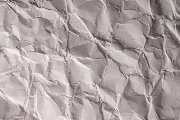 Zerknittertes papier. blatt grauweißes papier. detaillierte hochauflösende textur. abstrakter hintergrund für tapeten.