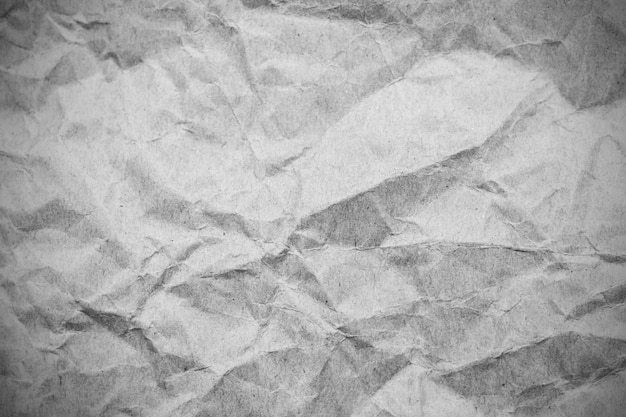 Zerknittertes papier grauen hintergrund