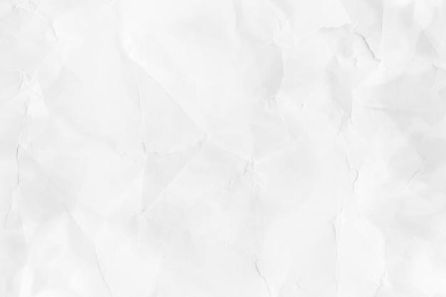 Zerknittertes weißes papier strukturierter hintergrund