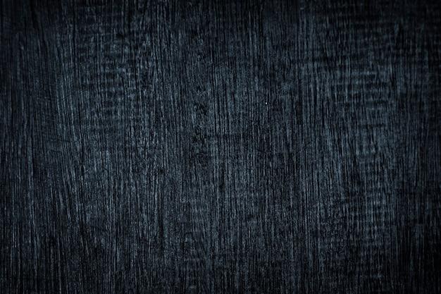 Zerkratzter dunkelblauer strukturierter holzhintergrund