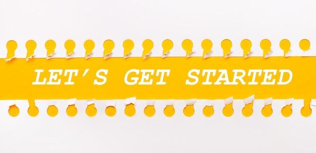 Zerrissener papierstreifen auf gelbem hintergrund mit text let is get started