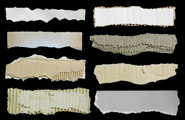 Zerrissenes papier auf schwarzem hintergrund für werbetexte