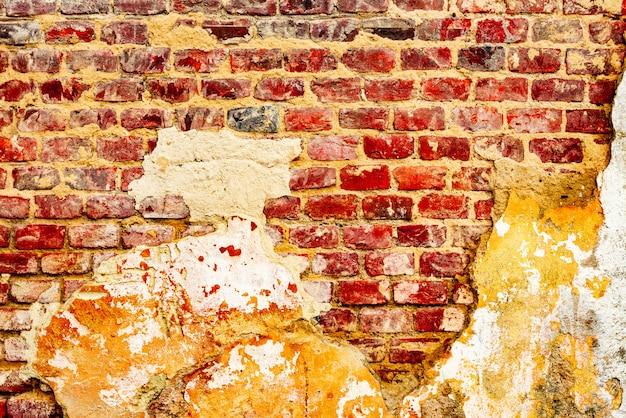 Ziegelsteinbeschaffenheit mit kratzern und sprungshintergrund