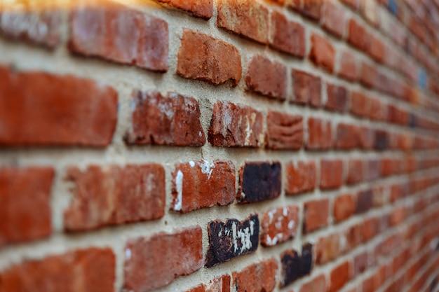 Ziegelsteinmauer. abstrakter hintergrund mit alter backsteinmauer, weichzeichnung