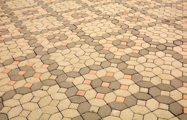 Ziegelsteinpflastersteine auf einer bürgersteighintergrundbeschaffenheit