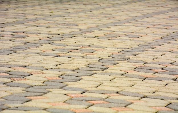 Ziegelsteinpflastersteine auf einer bürgersteigshintergrundbeschaffenheit
