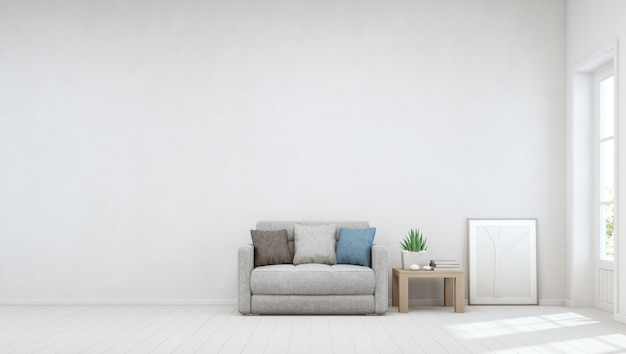 Zimmerpflanze auf hölzernem couchtisch und kleinem sofa mit leerer weißer betonmauer