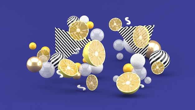 Zitrone unter den bunten kugeln auf dem purpur. 3d-rendering.