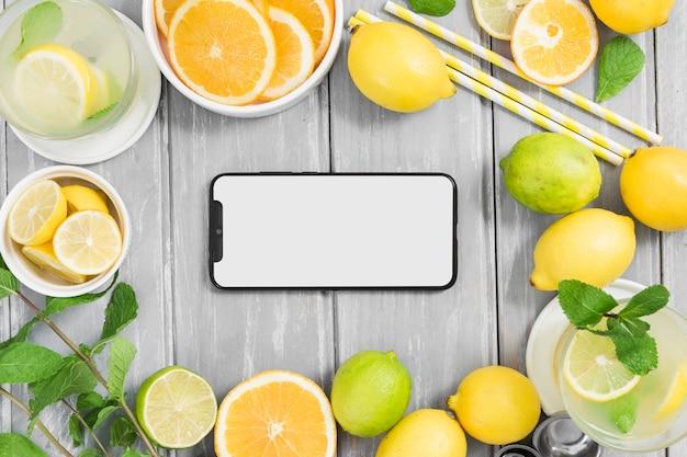 Zitrusfruchtrahmen mit smartphone