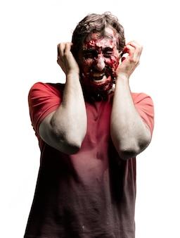 Zombie hände auf ohr