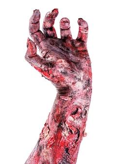 Zombie-hand, die aus dem boden kommt, isolierte weiße oberfläche, halloween-hand.