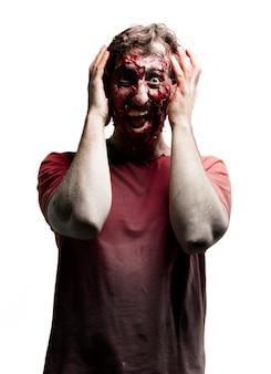 Zombie mit den händen auf den kopf