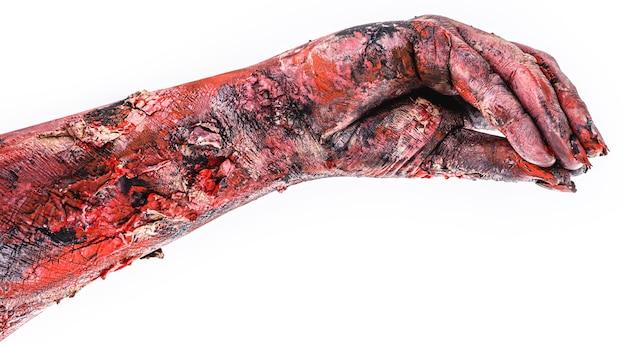 Zombie oder lebende tote realistische hand, tag des toten oder halloween-themas, isolierte weiße oberfläche.
