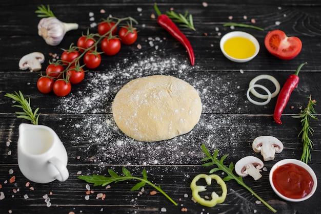 Zubereitung von teig und gemüse zur herstellung von pizza