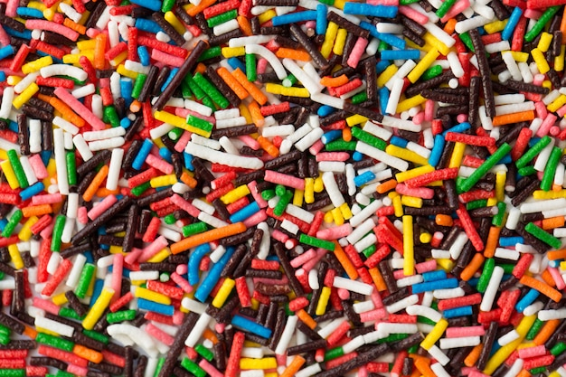 Zucker streuen punkte, dekoration für kuchen und becher, viele streusel als hintergrund