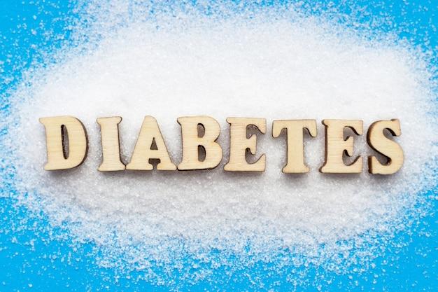 Zuckerrutsche und diabetes-inschrift auf blauer draufsicht