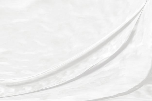 Zusammenfassung des weißen stoffhintergrundes mit weichen wellen.
