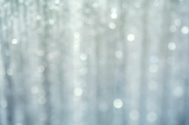 Zusammenfassung mit verschwommenem weißem licht, weiß und silber