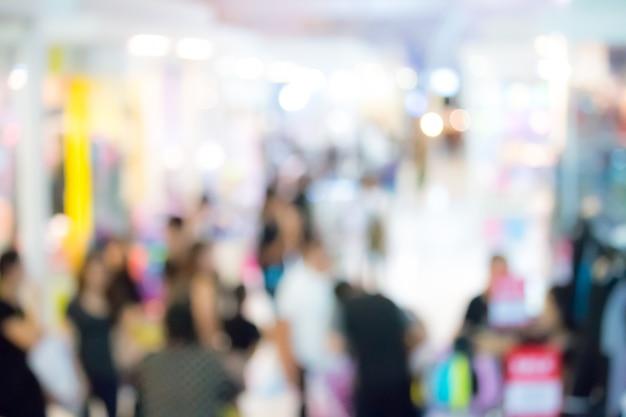 Zusammenfassung unscharfe leute im einkaufszentrumhintergrund