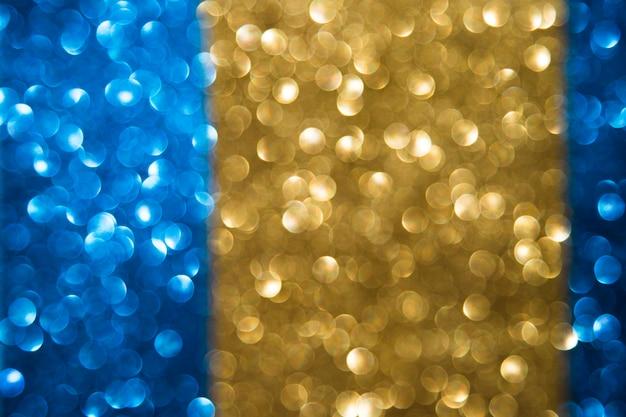 Zusammenfassung unscharfer blauer und goldener bokeh hintergrund