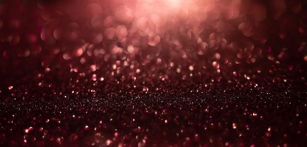 Zusammenfassung von goldenen und roten glitzerlichtern mit bokeh defokussiertem hintergrund