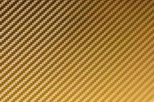 Zusammengesetzter rohstoffhintergrund der goldkohlenstofffaser