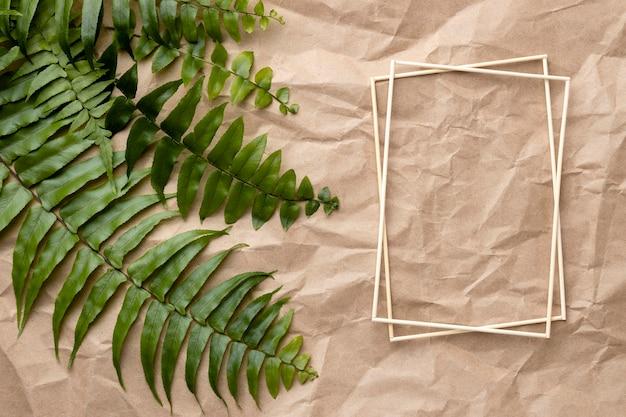 Zusammensetzung der grünen blätter mit leerem rahmen