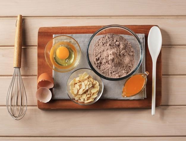 Zutat von schokoladenkuchen brownies in ländlicher oder rustikaler küche