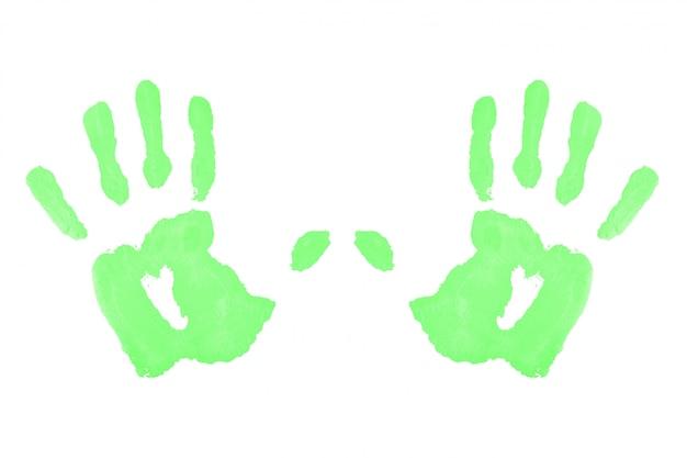 Zwei grüne symmetrische handabdrücke