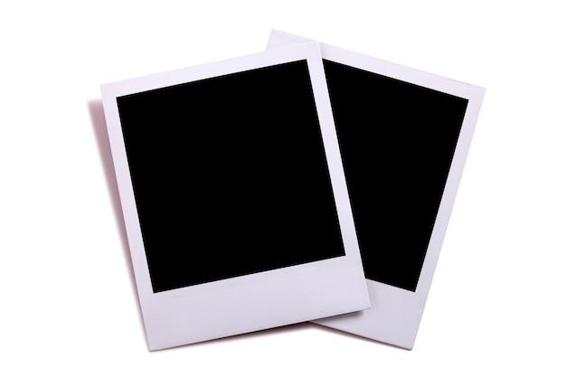 Zwei leere instantkamera fotodrucke