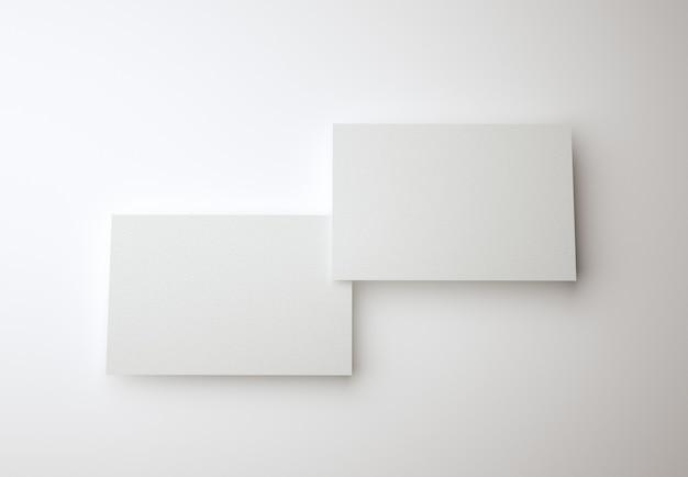 Zwei leere weiße visitenkarten visitenkarten-designvorlage