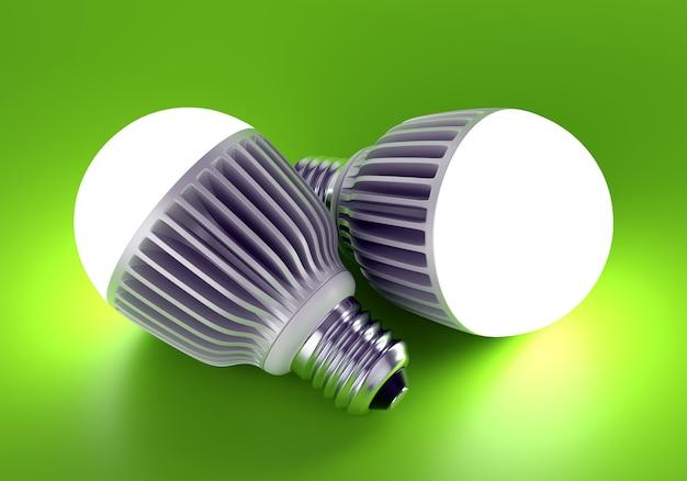 Zwei leuchtende led-energiesparlampen. auf grünem hintergrund. 3d-darstellung