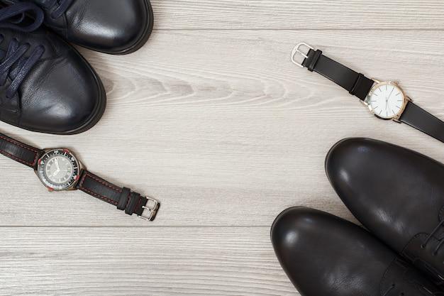 Zwei paar schwarze leder herrenschuhe und zwei armbanduhren herren accessoires