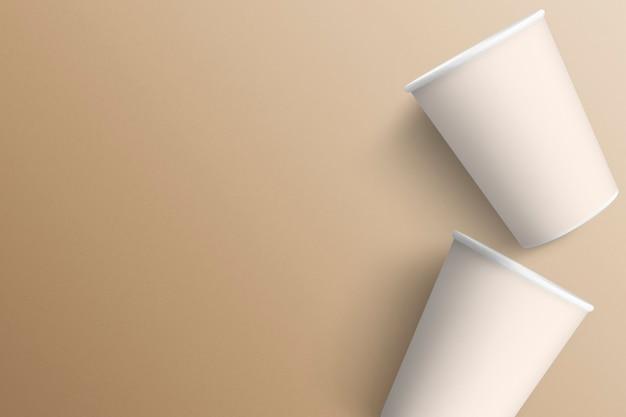 Zwei paperc-ups auf minimalem hintergrund